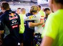 An emotional Sebastian Vettel embraces his trainer Heikki Huovinen in the paddock
