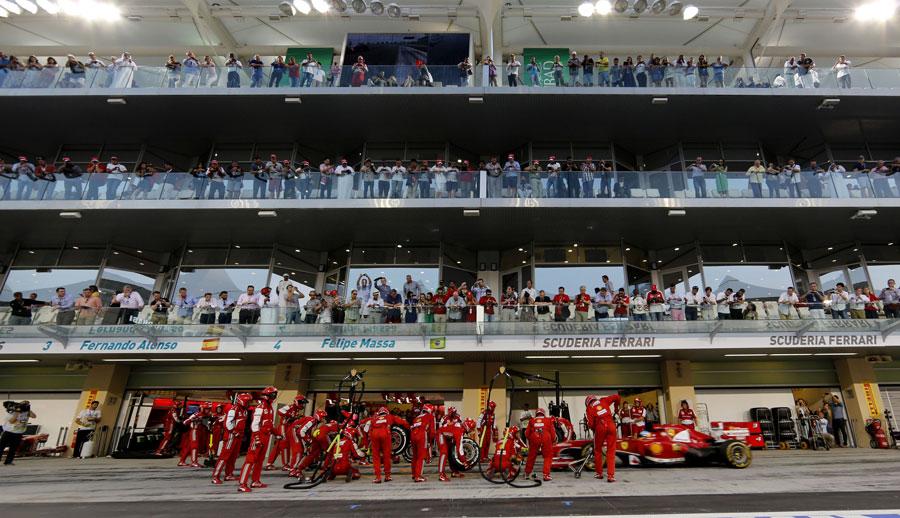 Fernando Alonso makes a pit stop