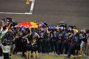Red Bull celebrate as Sebastian Vettel wins the race