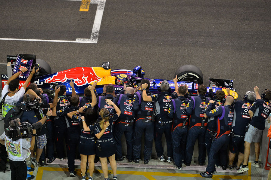 Red Bull celebrate as Sebastian Vettel wins the race