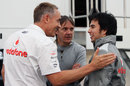 Martin Whitmarsh jokes with Sergio Perez in the paddock