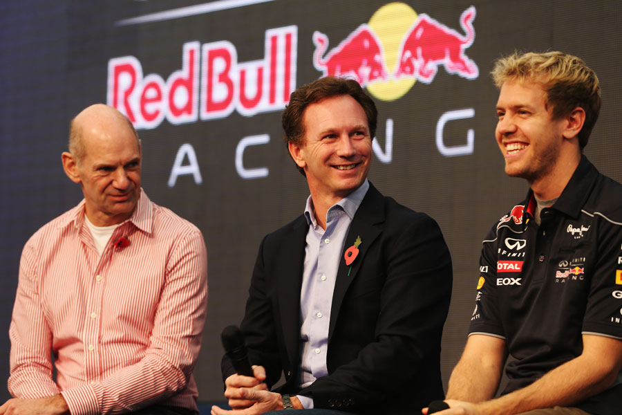 Adrian Newey, Christian Horner and Sebastian Vettel face the press at Red Bull HQ