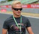 Heikki Kovalainen walks the track