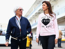 Bernie Ecclestone arrives in the paddock with his wife Fabiana Flosi