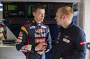 Daniil Kvyat chats with an engineer in the Toro Rosso garage