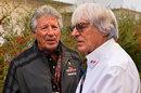 Mario Andretti chats with Bernie Ecclestone