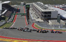 Sebastian Vettel leads the field in to Turn 1