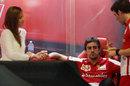 Fernando Alonso in the Ferrari garage with girlfriend Dasha Kapustina