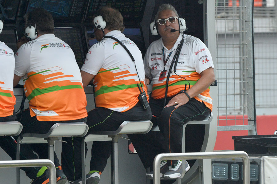 Vijay Mallya watches on from the Force India pit wall
