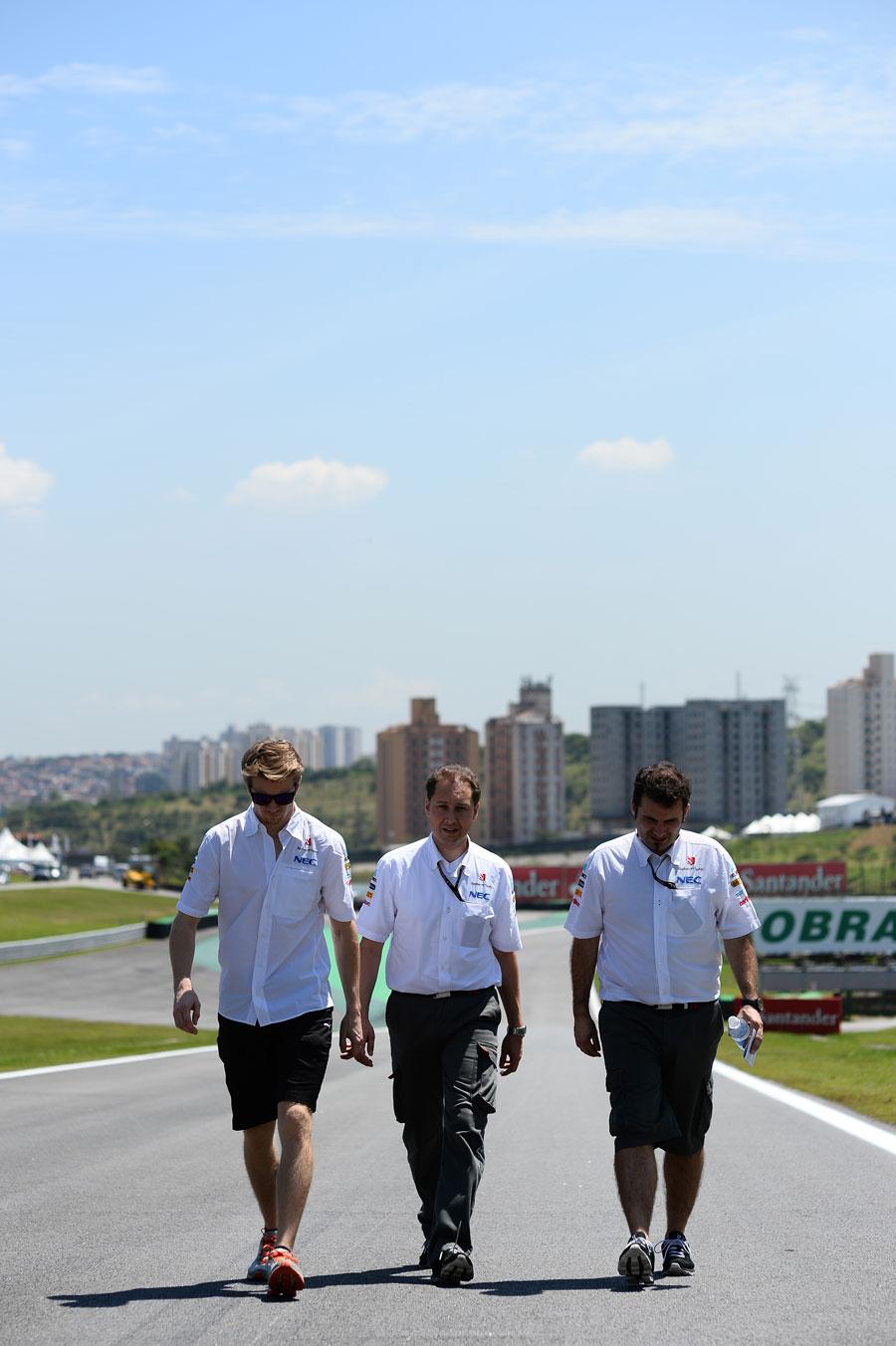 Nico Hulkenberg walks the track