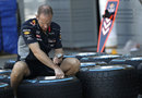 A Red Bull mechanic prepares wet weather tyres