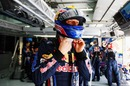 Mark Webber adjusts his helmet