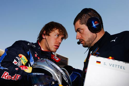 Sebastian Vettel talks to his race engineer