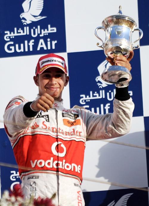 Lewis Hamilton celebrates his podium finish