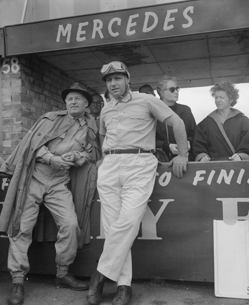 Juan Manuel Fangio talking to Mercedes team member Karl Kling