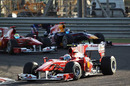 Fernando Alonso leads Felipe Massa and Sebastian Vettel