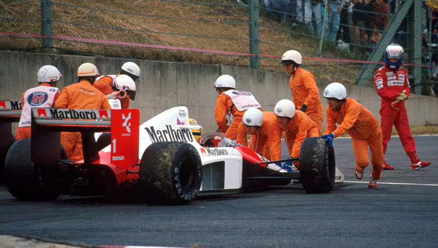 Alain Prost walks from his car following a collision with team-mate Ayrton Senna at the entrance to the chicane