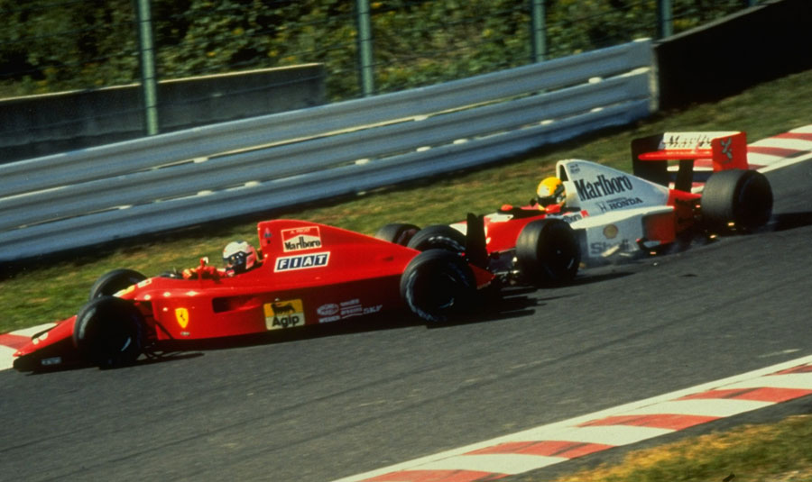 Ayrton Senna takes out Alain Prost on the first corner of the 1990 Japanese Grand Prix