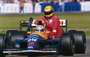 Nigel Mansell gives title-rival Ayrton Senna a lift back to the pits