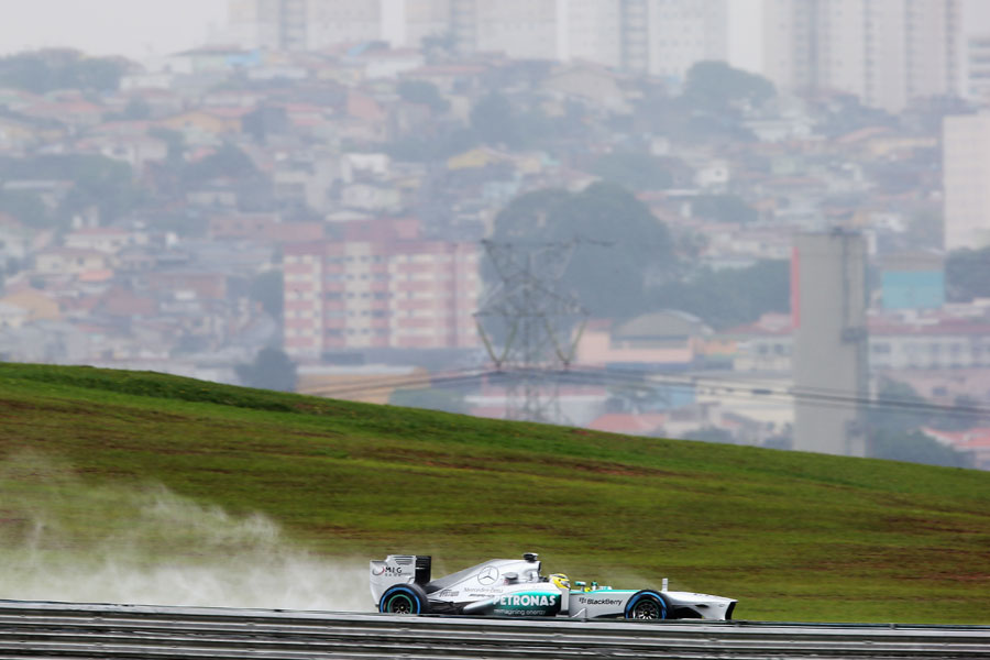 Nico Rosberg leaves a plume of spray during FP2