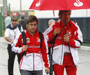 Fernando Alonso arrives at the circuit on Saturday morning
