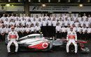 Sergio Perez and Jenson Button pose for a McLaren team photo