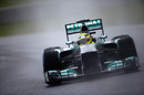 Nico Rosberg battles the drizzle