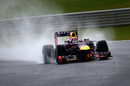 Mark Webber pilots his Red Bull through the rain