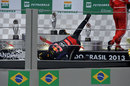 Mark Webber falls over on the podium celebrating second place in his final race