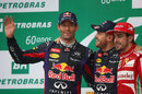 Mark Webber waves to the crowd on the podium alongside Sebastian Vettel and Fernando Alonso