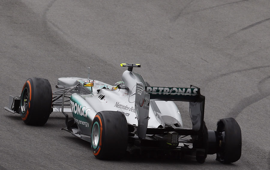 Lewis Hamilton with a puncture after colliding with Valtteri Bottas