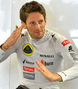 Romain Grosjean shows off his judo moves in the Lotus garage