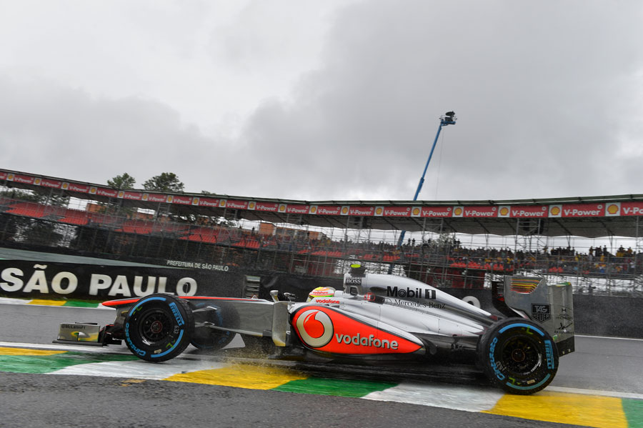 Sergio Perez leaves the pits on full wet tyres