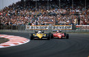 Alain Prost finds a way past Rene Arnoux at Copse