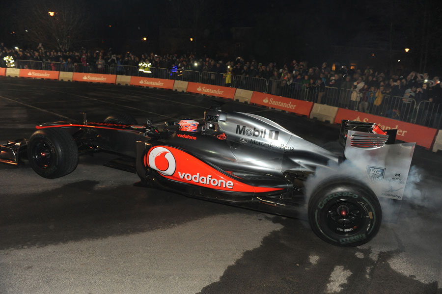 Jenson Button performs doughnuts in his home town of Frome