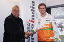 Force India boss Vijay Mallya and Nico Hulkenberg shake on a deal for a 2014 drive