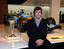 Fernando Alonso poses with his championship-winning Renault RS26 at his museum opening