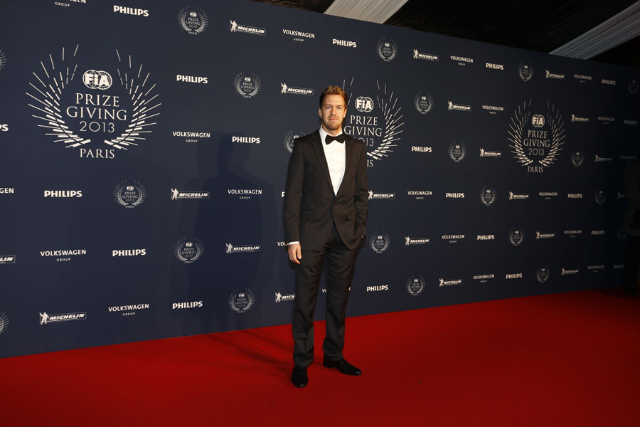 Sebastian Vettel arrives at the FIA prize-giving gala