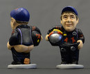 A traditional Catalonian caganer - a ceramic figurine - of Sebastian Vettel, apparently