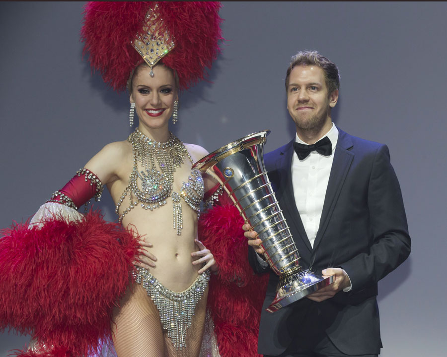 Sebastian Vettel receives his drivers' championship trophy