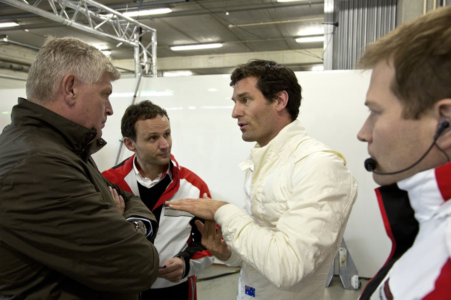 Mark Webber chats to his engineers after his first test in Porsche's LMP1 car