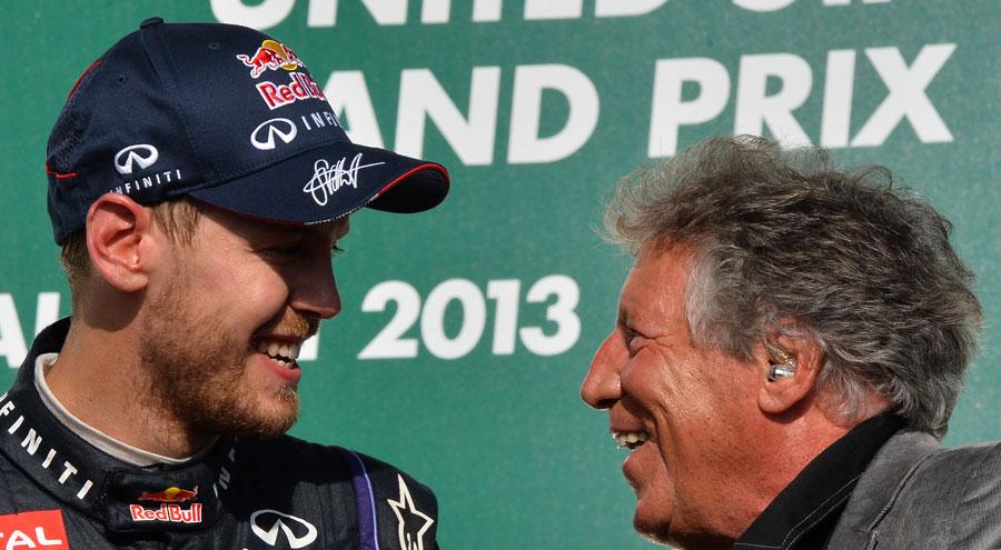 Sebastian Vettel shares a joke with Mario Andretti