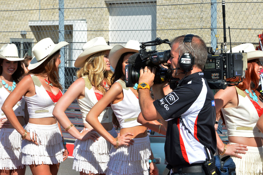 A Sky Sports cameraman films grid girls ahead of the race