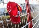 A cap with Dutch handwriting reading 'get well soon, number one' near the entry of the Michael Schumacher kart-centre