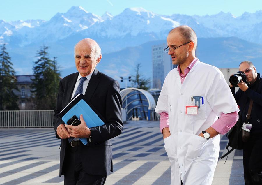 Surgeon and Michael Schumacher's friend professor Gerard Saillant and professor Jean-Francois Payen leave a press conference