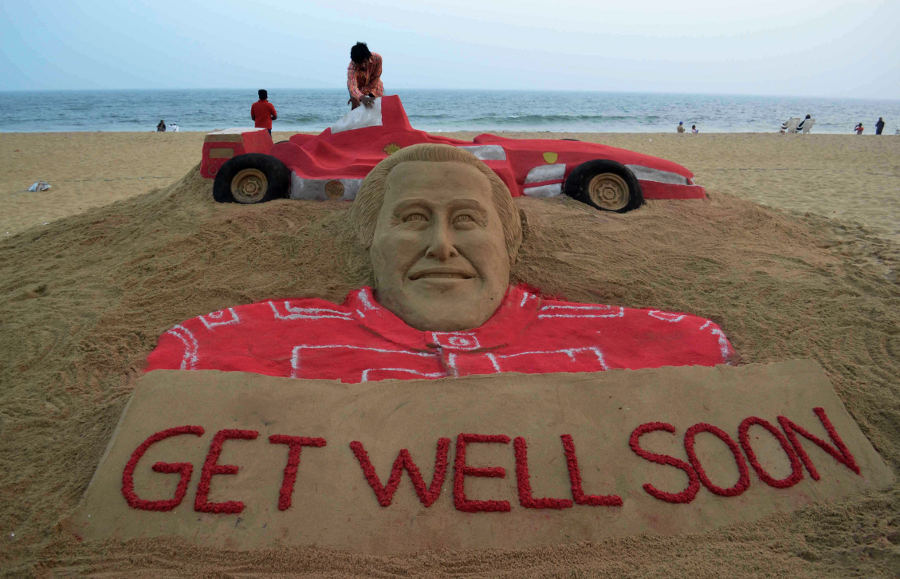 An Indian sand artist puts the final touches on his tribute to Michael Schumacher