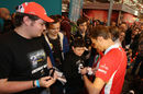 Max Chilton signs autographs for fans at the Autosport International Show