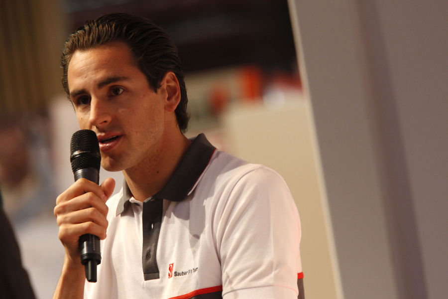 Adrian Sutil answers questions at the Autosport International Show