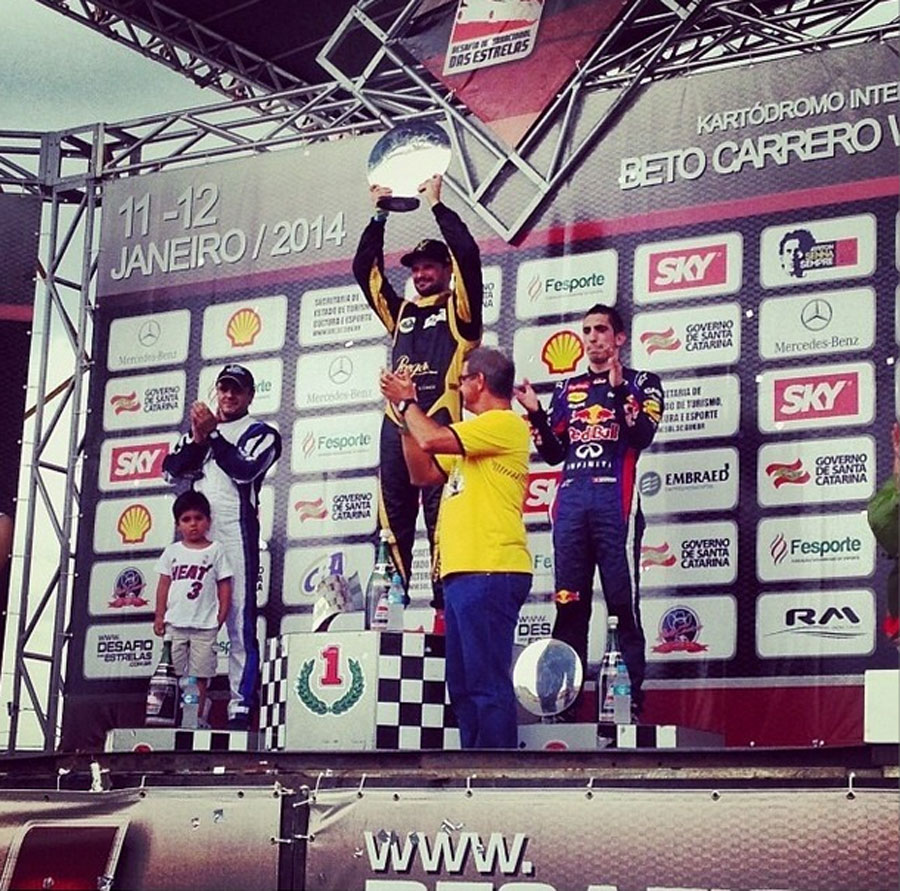Vitantonio Liuzzi celebrates his victory in Felipe Massa's karting event alongside Sebastien Buemi and Massa