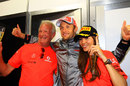 Jenson Button celebrates his victory with girlfriend Jessica Michibata and father John